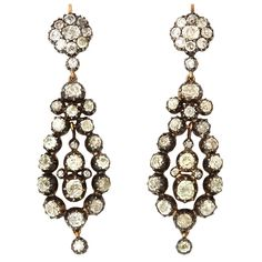 Georgian Diamond Earrings  England, Early 1800's.  A pair of silver on gold drop earrings, collet set with Old Mine Cut Diamonds.