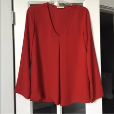 BNWOT long sleeve chiffon blouse This flowy blouse is such a cute option to add to any wardrobe! It's too big for me and needs to find a new home! V-neck. Super lightweight and comfy. Dear apple Tops Blouses