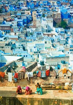 Brightly colored houses in Jaipur, India make a mosaic like skyline.