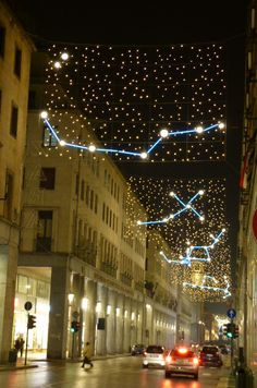 Even though this is Turin aka Torino, Italy at Christmas, we're still very impressed by constellations made from string lights over the roadway. We would enjoy that sight any day of the year! Amazing Architecture, Architecture Art, Commercial Christmas Lights, Street Light Design, Landscape Lighting Design, Point Light, Parking Design, Urban Furniture, Light Installation