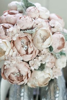 Bouquet   Emici Bridal... Love the bling-bling in the middle