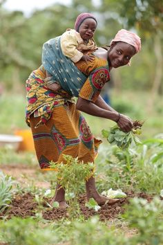 Women in Africa work very hard! Often they carry their babies on their back while they do other work.