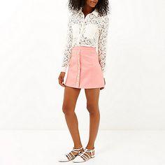 Light pink button-up A-line mini skirt