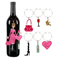 """Sunset Vista Designs Divas and Dames Refrigerator Magnet and Wine Charm Set, The Queen by Sunset Vista Designs. $13.99. Metal bottle charm measures approximately 9"""" long x 3.5"""" wide, doubles as a refrigerator magnet. Use metal charms for wine stem tags or place around napkins for party place settings. Sunset vista designs has everything you need to add character and charm to your protected outdoor area or indoor space. Decorate with a compelling array of fun and fashionab..."""
