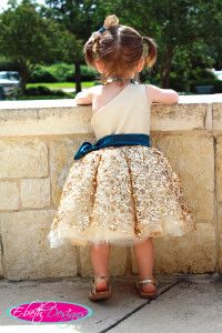 Gold flower girl dress - @Emily Schoenfeld Huebner love this?! With a different sash, maybe coral or black!