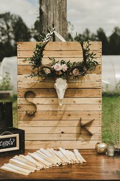 wedding display signs - photo by Shari and Mike http://ruffledblog.com/eclectic-boho-wedding-with-charming-rustic-touches