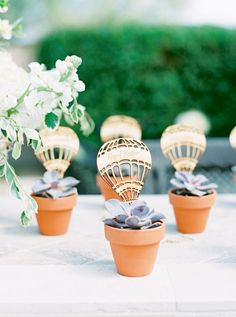 Hot air balloon garden planters baby shower favors: http://www.stylemepretty.com/living/2016/10/02/a-hot-air-balloon-shower-thats-up-up-and-away-with-our-hearts/ Photography: Melissa Jill - http://www.melissajill.com/