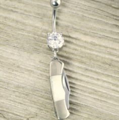 Cool pocket knife belly ring! If I ever get my belly button pierced....