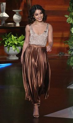 Vanessa Hudgens and A.L.C Bobby Pleated Metallic Midi Skirt, Bar III Metallic Tank Sweater, Schutz Cadey-Lee Sandals. See the latest Vanessa Hudgens style, fashion, beauty, trends, wardrobe and accessories.
