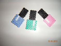 This is 3 Perler Bead Nail Polish Designs. Included is one of each color, pink, periwinkle, and aqua green. Each is approximately 1 and 7/8 inches high. Fun design for the nail polish loving person in your life.