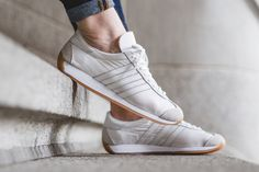 adidas Country OG White Gum featuring an all-White leather upper that also comes built with nylon and suede sitting atop a Gum rubber outsole. Adidas Country, Sneaker Bar, Adidas Superstar, White Leather, Detroit, Adidas Sneakers, Shoes, Fashion, Zapatos