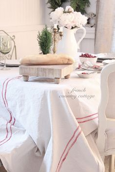 Drop Cloths can be used to made into a table cloth. Try this very simple, very affordable project. FRENCH COUNTRY COTTAGE: French Grainsack Inspired