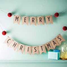 merry christmas bunting with pom poms by paper and wool | notonthehighstreet.com