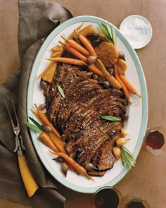Braised Brisket with Carrots, Garlic, and Parsnips | Martha Stewart Living - Brisket is often part of a traditional Passover meal. For step-by-step photos, see our Brisket 101 How-To.