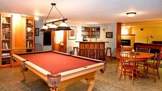 Game room with pool table and full wet bar.