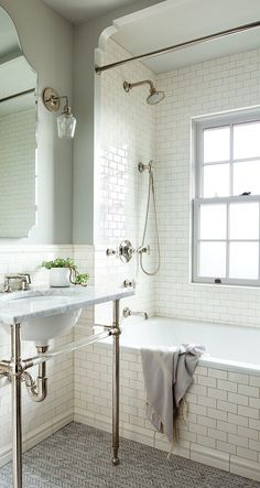 White subway tile bathroom with vintage architectural details
