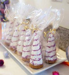 sugarcone dipped in white chocolate & drizzled w/ ?, wrapped in cellophane & tied w/ sparkly bow