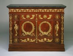 "1810-1813 French Writing cabinet at the Philadelphia Museum of Art, Philadelphia - From the curators' comments: ""[The] commode is typical of the large mahogany case furniture with classically inspired ornament, such as the laurel wreaths and lyres seen here, that was fashionable during the Napoleonic Empire (1804-14). Napoleon, eager for his empire to be compared to those of Greece and Rome, adopted classical motifs as his symbols and encouraged their use in furniture."""