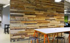 Whitmarsh built 2 of these custom salvaged wood walls in an office building in San Francisco. Each wall is 11 feet by 15 feet, and is made entirely out of salvaged shipping palette wood.