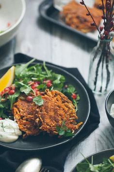 intensefoodcravings:  Sweet Potato Pancakes with Arugula Pomegranate Salad and Herbed Yogurt/80 Twenty
