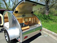 A fully equipped galley in the neatly hidden in the rear end of a teardrop camping trailer.
