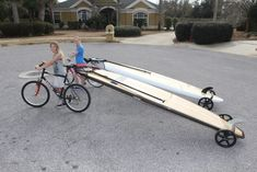 A lightweight and collapsible dolly and bike trailer for a stand up paddleboard.
