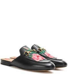 Gucci - Princetown leather slippers with embroidered appliqué - Gucci's iconic Princetown slippers are given an ornate update this season with a pretty rose appliqué to the toe, making for a romantic contrast with a tough-luxe feel. The brand's signature horse-bit embellishment is there for recognition – show yours off with high hemlines. seen @ www.mytheresa.com