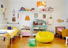 This is the overall feeling I want to achieve in the space. A mix of bright colors, balanced by simple white walls, neutral floors and warm wood tones. A sunny, happy play space that won't overwhelm its visitors. Also, mixing in lots of solid saturated color in tons of textures will make the space modern, but still very warm.