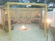 Outdoor gazebo with in ground fire pit and hand made swings. The gazebo is built with 44 posts in a hexagon shape spaced 7 feet apart. Fire Pit Swings, Gazebo With Fire Pit, Diy Fire Pit, Fire Pit Backyard, Fire Pits, Small Pergola, Pergola Swing, Deck With Pergola, Pergola Kits