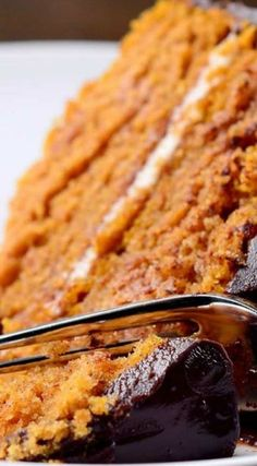 Pumpkin Cake with Chocolate Ganache ~ This moist, perfect pumpkin cake gets a layer of sweet cream cheese frosting in the middle before ganache is poured over the top