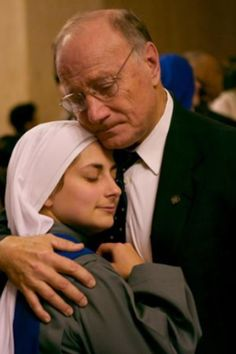 This is my boss's daughter. She recently became a nun. This picture shows their true feelings. She is so happy to have met her calling and he loves his daughter so but knows her life now belongs to Christ. I can finally look at this picture without crying.....both beautiful people, inside and out!