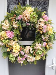 Pale Peach, Pink & Yellow Hydrangea with Green Peony Spring Wreath   This cheery spring wreath features clusters of hydrangea in pale shades of