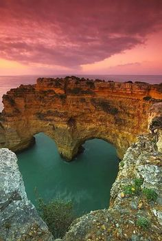 The photo above features the Heart Sea Arch in Portugal. Although the sea isn't really heart-shaped, the natural heart photography makes it a must-visit place in Portugal. Beautiful Places To Visit, Beautiful World, Amazing Places, Amazing Things, Beautiful Scenery, Beautiful Hearts, Beautiful Rocks, Beautiful Pictures, Amazing Photos