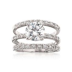 Middle ring being the engagement ring, two outside being the wedding bands. Bridal Set.