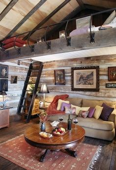 Swank cabin interior with lofted bed.