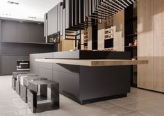 "Pure. Essential. ""The Cut-reconfigures- it surprises!It recognises the kitchen as a practical yet central space, a place to grab-and-go, a place to congregate and chat, a place to relax and dine. And it's designed to understand that each of these occasion present themselves daily in our fast modern lives. The Kitchen is produced by the Italian Kitchen maker : Record e' Cucine"" (Architizer). Designer: Alessandro Isola. Below the version made of FENIX NTM Nero Ingo. Smart."