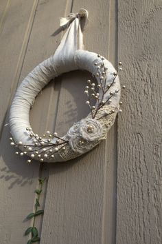 I adore this wintery wreath! Simple, but beautiful!