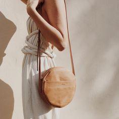 round tan handbag