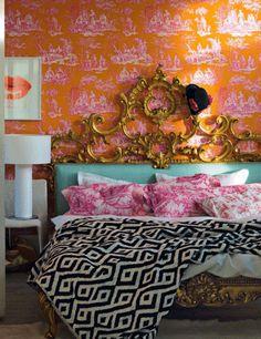 Toile wall + geometric print duvet + ornate headboard = Eclectic bliss