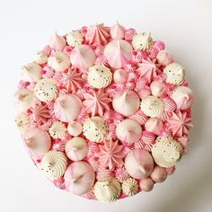 strawberry mousse cake topped with vanilla Meringue kisses
