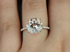 This is my favorite!!! Rose Gold. Thin, eternity Band. Round Cut. Solitaire diamond. I think I prefer white gold instead.