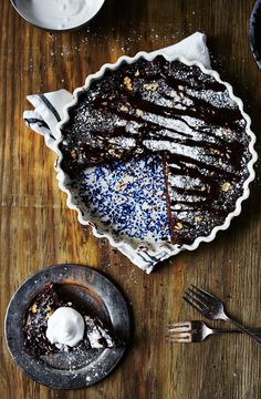 walnut brownie tart, chocolate ganache + whipped coconut creme.