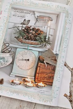 Winter display; pine cones etc arranged on vintage kitchen scales. Candles add warmth. Lovely idea!