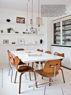 Amazing space - globe pendants plus the combination of chairs is wonderful.  Eames DCMs and  Grand Prixs (grand preezes?) by Arne Jacobson.