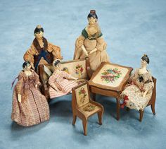 """4"""" (10 cm.) -7"""". Each of the five dolls is all-carved wood,with one piece head and torso,dowel- jointing of shoulders,elbows,hips and knees,and having carved painted black hair with delicately feathered or ringlet curls around the face,and three with yellow tuck combs,dowel-jointing at shoulders,elbows,hips and knees,painted shoes. Comments: Germany,early/mid-19th century."""