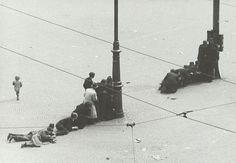 World War II. Liberation day. People seeking shelter behind lamp-posts at Dam square Amsterdam after German troops opened fire at the celebrating masses (22 killed, 120 injured). One of the pictures from the two films that Dutch photographer Wiel van der Randen consumed during the shoot-out on Dam square. Amsterdam, The Netherlands, May 7, 1945.