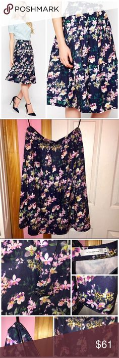 "ASOS Style London Floral Midi Skirt Brand is Style London from ASOS. Only tried on and has been washed. Pleated skirt. All over floral print. Has a back zipper. 95% polyester and 5% elastane. Measurements: waist is approx 30"" and length is approx 27"". Stock photos from ASOS. ❌NO TRADES❌ ASOS Skirts Midi"