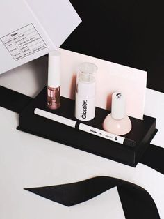 Find the best and most chic bridal shower gifts here, like the Glossier Black Tie Set..