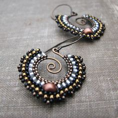 http://windyriver.tumblr.com/post/71412055647/more-bollywood-inspired-earrings-brass-with-seed