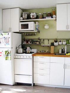 microwave on shelf over oven- potentially cookbooks on shelf over that?